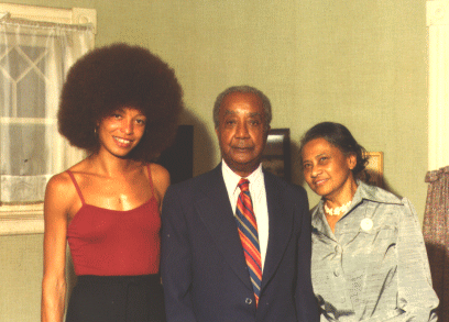 [Photo of Angela Davis with Jim Grant's parents]
